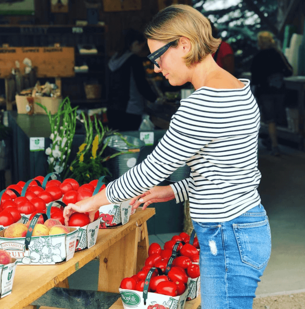 woman shopping for tomatoes