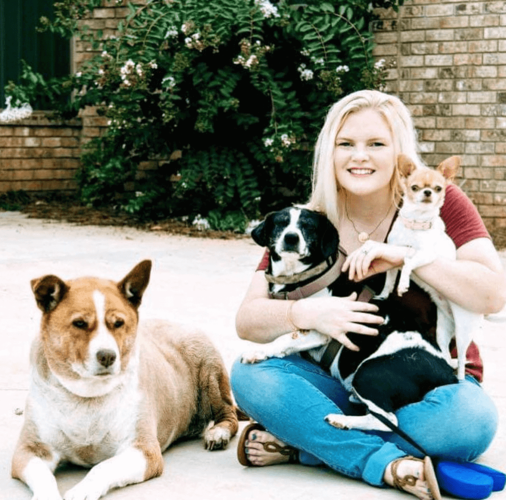 woman with three dogs