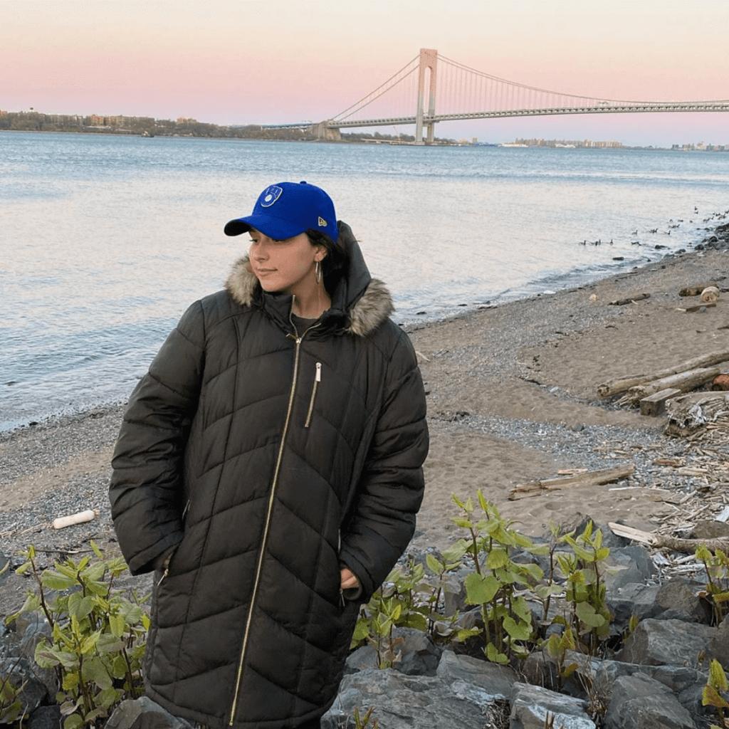 woman in front of bridge
